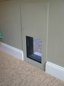 Automatic dog doors into the wall