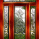 Wooden front doors with glass tracery